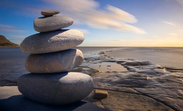 5 stacked stones, water and beautiful sky