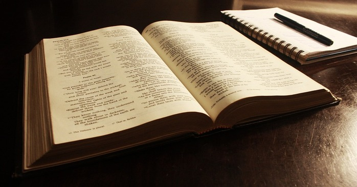 Open Bible, notebook & pen