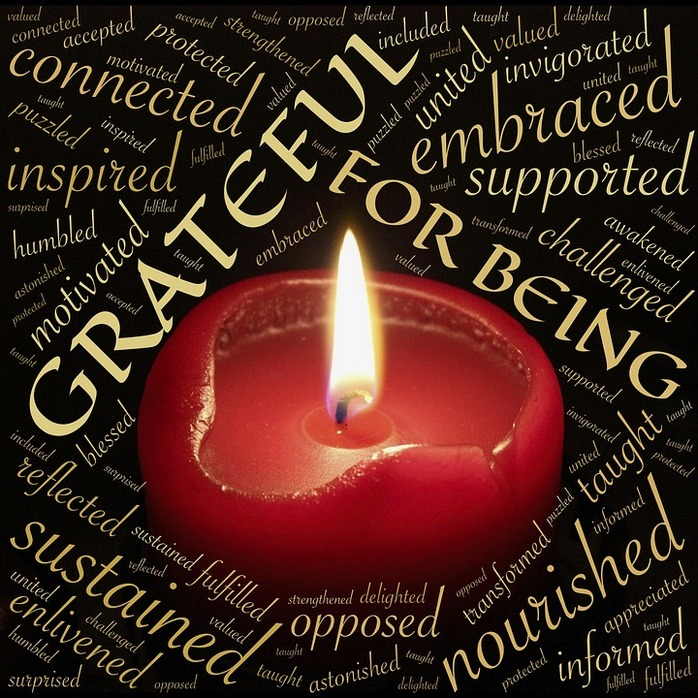 red candle and grateful words