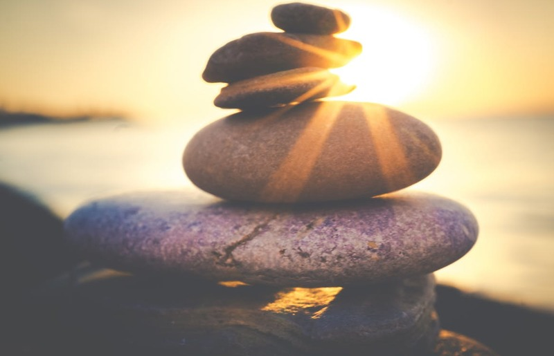 stones stacked in the sunlight  - Living in the Presence of God