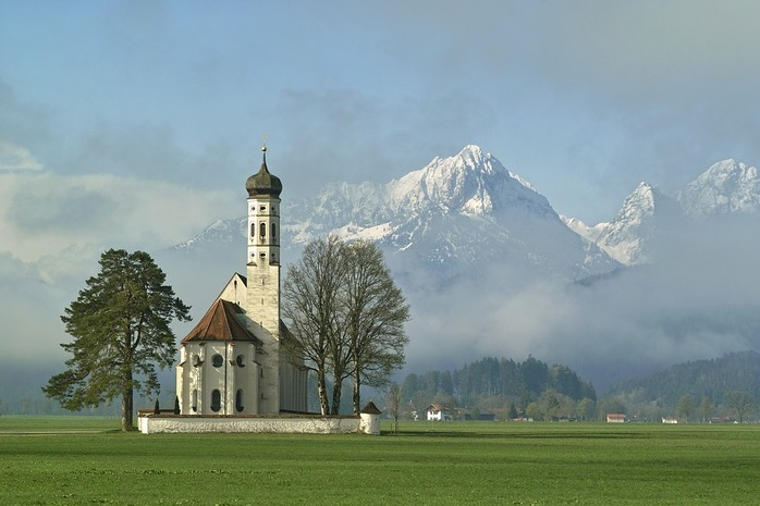 white church with mountains in the background