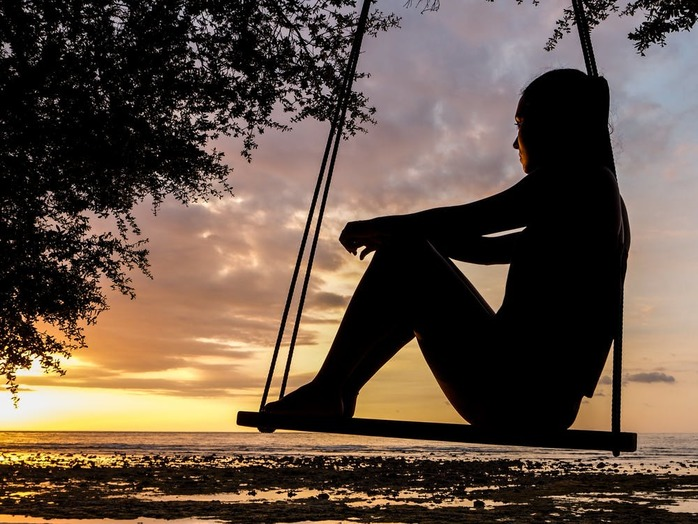 woman sitting on a swing